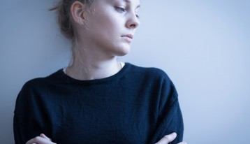 facing the root causes of addiction - depressed woman - ranch at dove tree