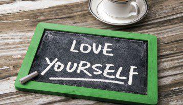 love yourself written on small chalk board