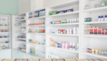 pharmacy shelves blurred