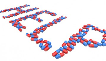 the word help spelled out in blue and red capsules