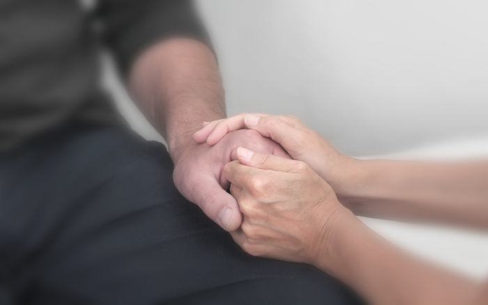 comforting someone - holding hands