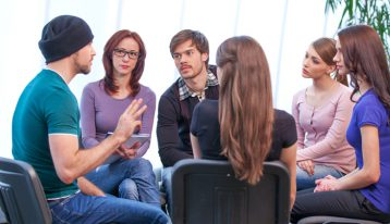 what are collegiate recovery programs - college students in group therapy - ranch at dove tree