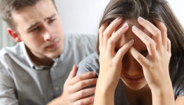 How to Know if Your Loved One Has an Addiction - man comforting woman - ranch at dove tree