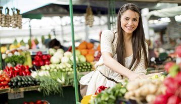 The Link Between Nutrition and Recovery - woman in outdoor market