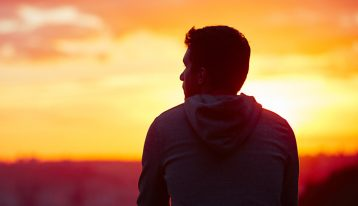 10 Reasons to Get Sober - man thinking at sunset