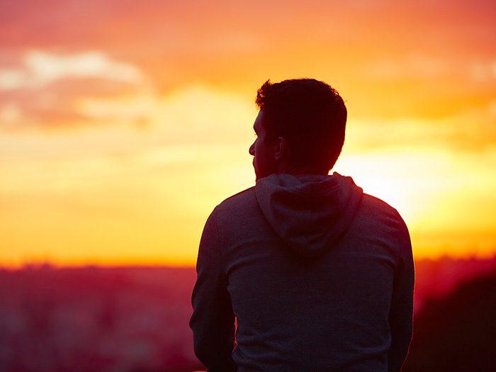 10 Reasons to Get Sober - man thinking at sunset
