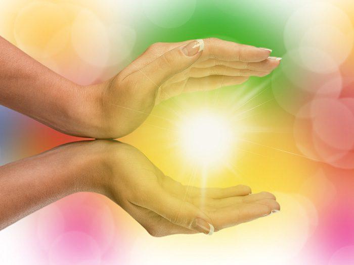 hands holding burst of light