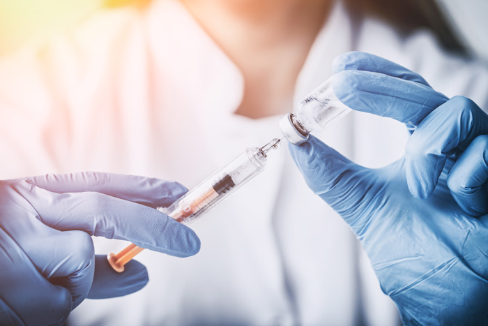 Could Vaccines Combat Drug Abuse? - doctor holding vaccine