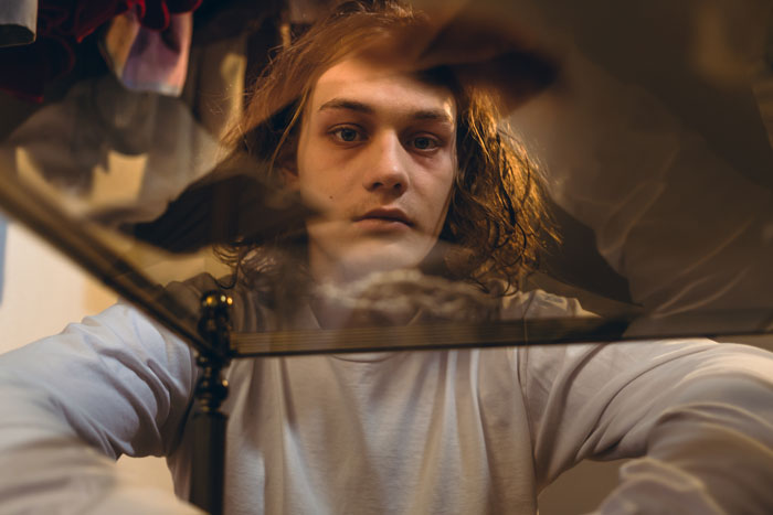 Drugs-and-College-Campuses-What's-Happening-and-Where-to-Get-Help - strung out college kid through glass table male