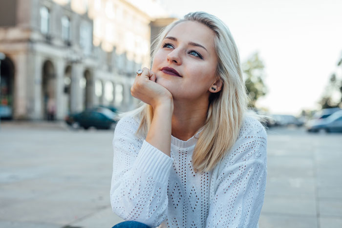 young blonde woman looking hopeful