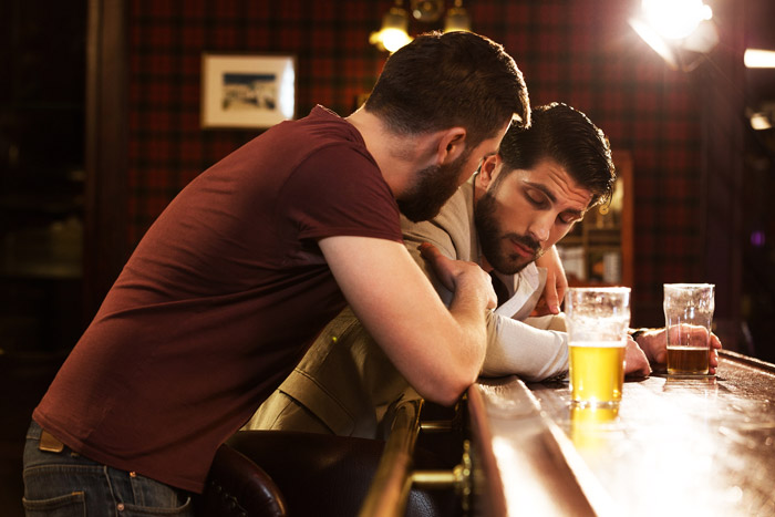 man worried about friend at bar
