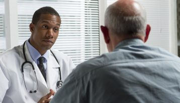 african american doctor speaking to his patient