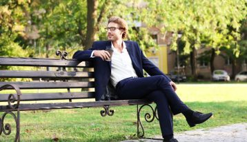 man sitting on park bench - identity