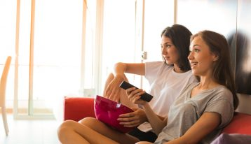 female roommates watching tv together - transitional program