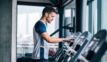 man on treadmill at gym - stress