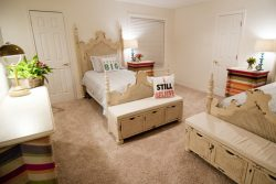 ivory and cream colored bedroom with two beds