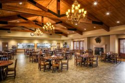 beautiful dining hall with chandeliers, and raised wooden beam ceiling
