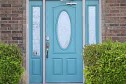 robin's egg blue front door to brick home