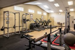 workout room with fitness equipment and weight benches