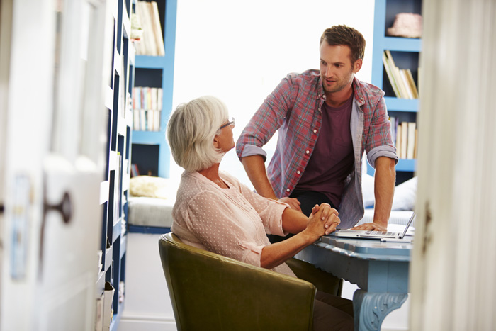 adult son talking to senior mother - enabling