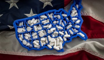 pills in shape of the United States on US flag - epidemic
