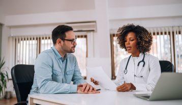 man talking to female doctor - drug detox