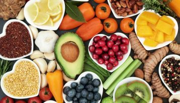 an array of healthy fruits, grains, nuts, and vegetables - nutritional
