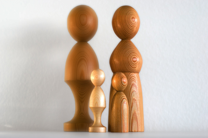 four wooden figurines on white background - family therapy