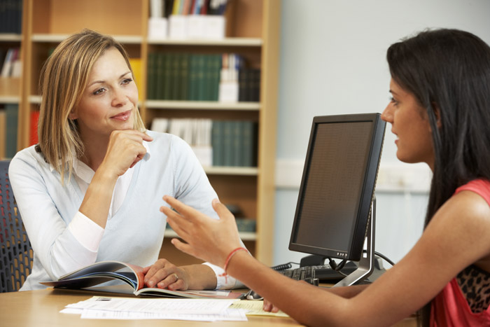 young woman talking to college intake coordinator - after treatment