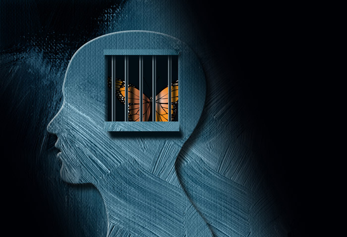 illustration of monarch butterfly trapped in cage of human head silhouette - trauma