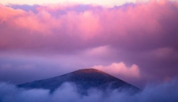 bright pink clouds over the top of a mountain - pink cloud experience