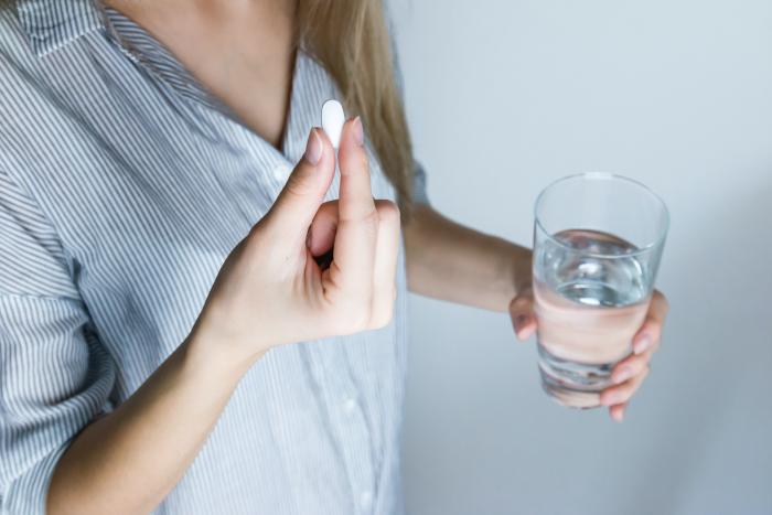 Woman taking medication - Xanax