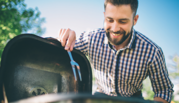 Man cooking meat on barbecue - BBQ